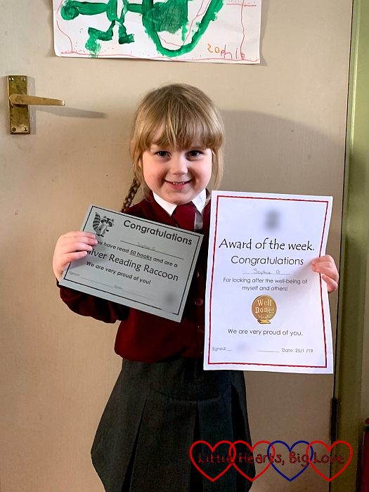Sophie with her Silver Reading Raccoon certificate and her Award of the Week certificate