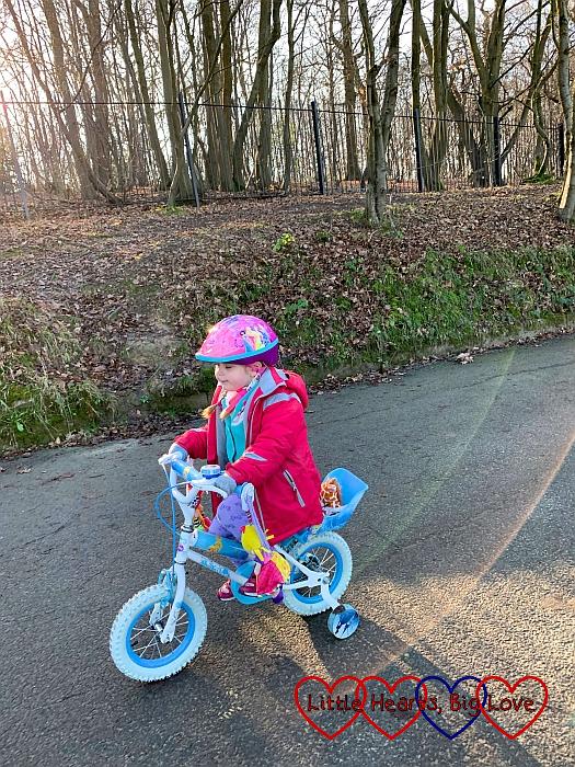 Sophie riding her bike at Ruislip Lido