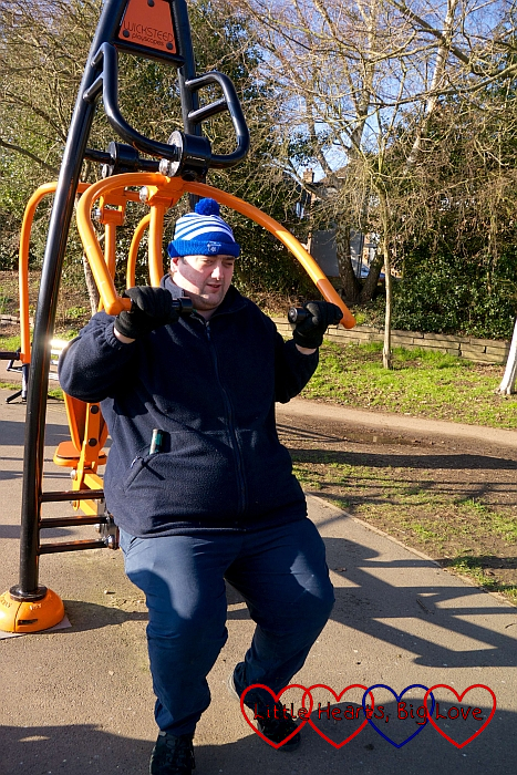 Hubby using the outdoor gym equipment