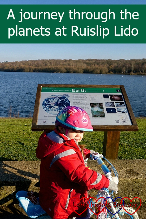 "Sophie on her bike looking at the 'Earth' information board - ""A journey through the planets at Ruislip Lido"""