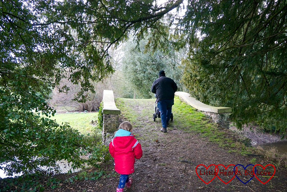 Hubby and Sophie heading over a bridge at West Wycombe Park