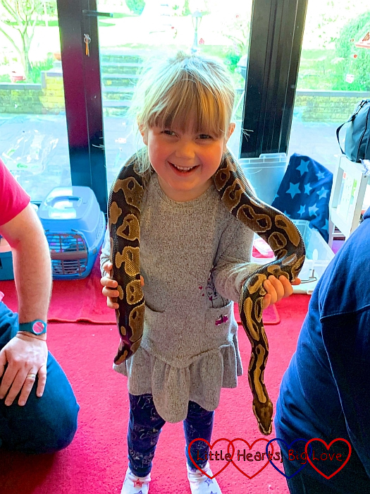 Sophie with a snake around her neck