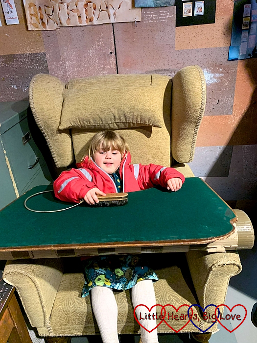 Sophie sitting in a replica of Roald Dahl's writing chair