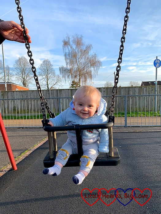 Thomas on the swings at the park