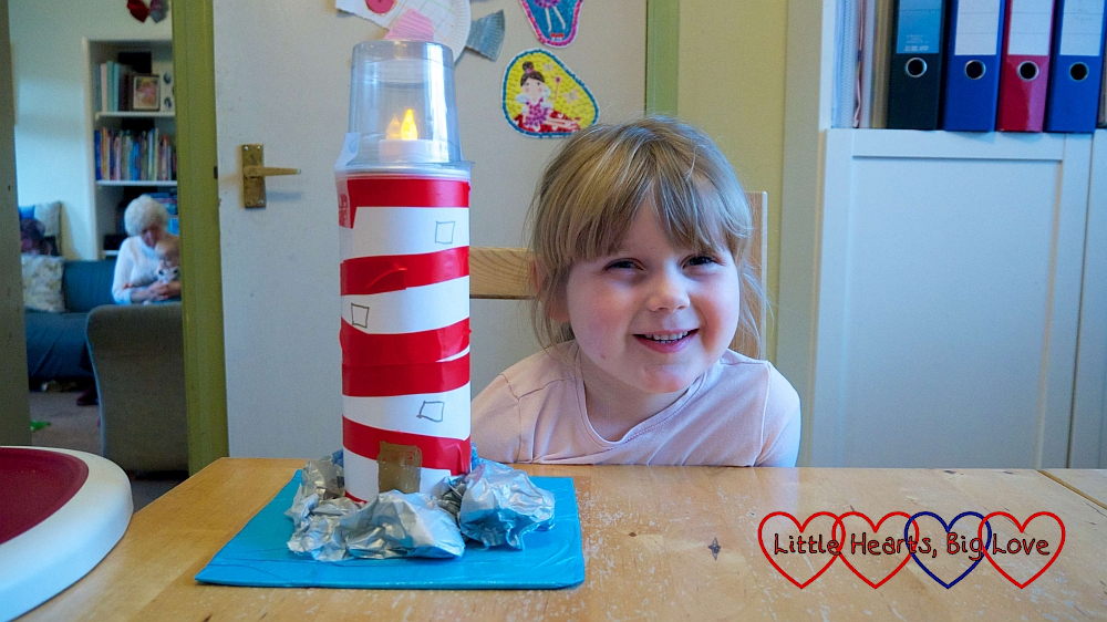 Sophie with her finished cardboard tube lighthouse