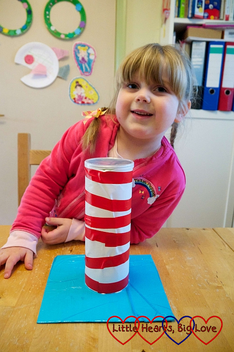 Sophie with the red and white striped tube glued to the blue cardboard base