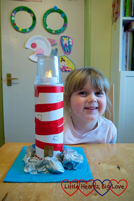 Sophie with the finished lighthouse with details added with marker pen
