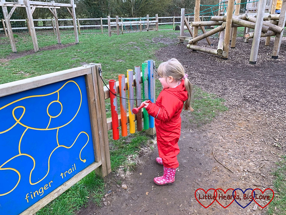 Sophie playing the xylophone in the children's play area