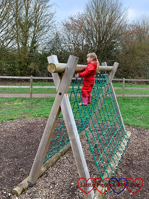 Sophie at the top of the climbing frame