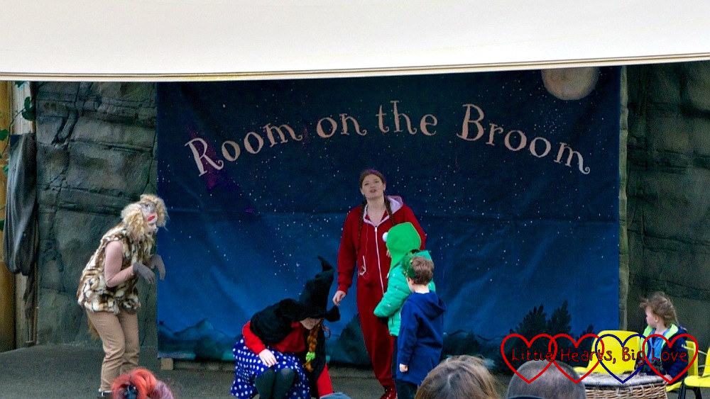 The dragon, witch and animals on stage for the Room on the Broom story time