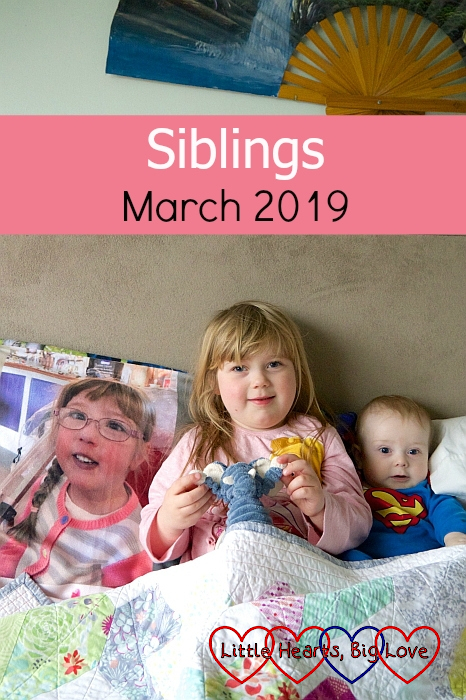 "Sophie and Thomas sitting on my bed in their pyjamas next to Jessica's photo blanket - ""Siblings - March 2019"""