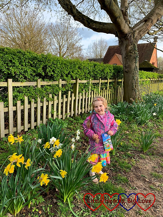 Sophie standing amongst a patch of daffodils at Charlecote Park