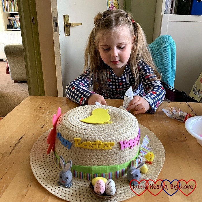 Sophie decorating her Easter bonnet