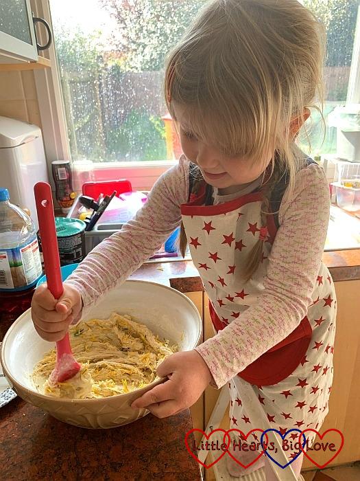 Sophie mixing dandelion petals into the biscuit dough