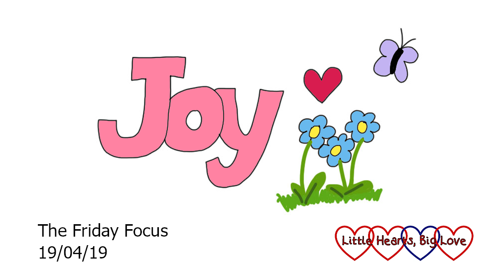 The word 'joy' with flowers, a heart and a butterfly