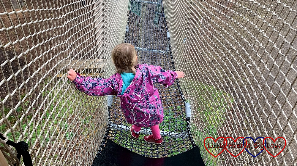 Sophie walking along one of the net walkways at Nets Kingdom