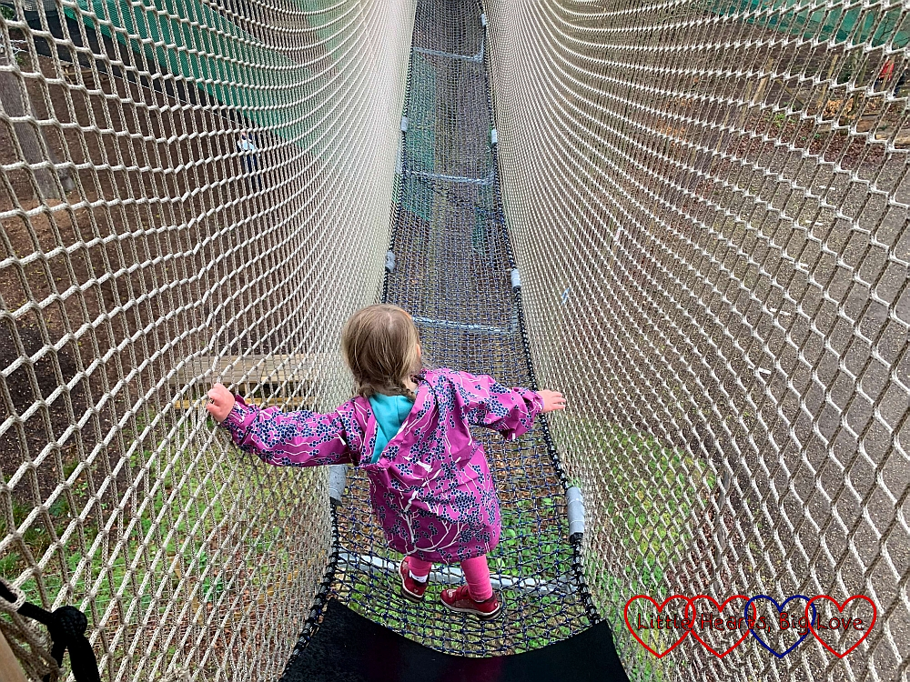 Sophie walking along one of the net walkways at Nets Kingdom