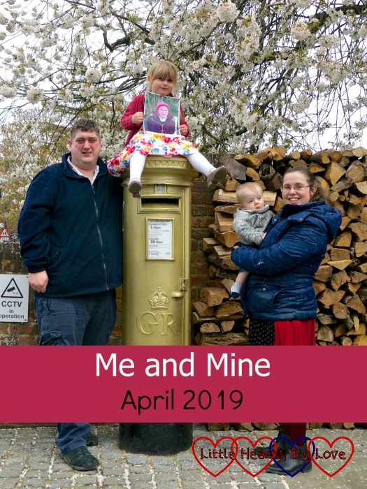 "Hubby Sophie (holding a picture of Jessica), Thomas and me at a gold postbox - ""Me and Mine - April 2019"""