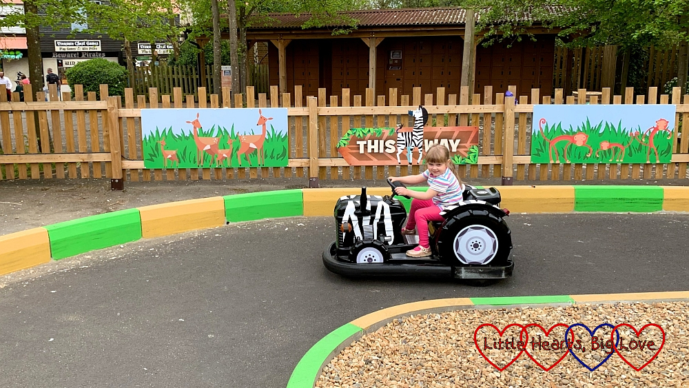 Sophie on one of the Safari Riders cars at Chessington
