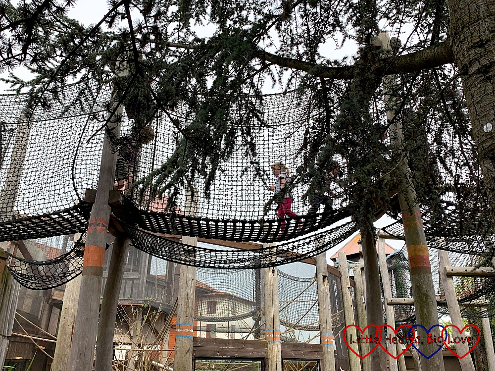 Sophie running through the nets in Amazu Treetop Adventure