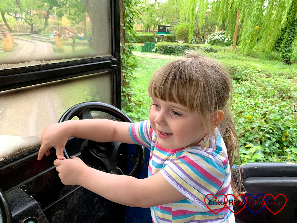 Sophie driving one of Toadie's Crazy Cars