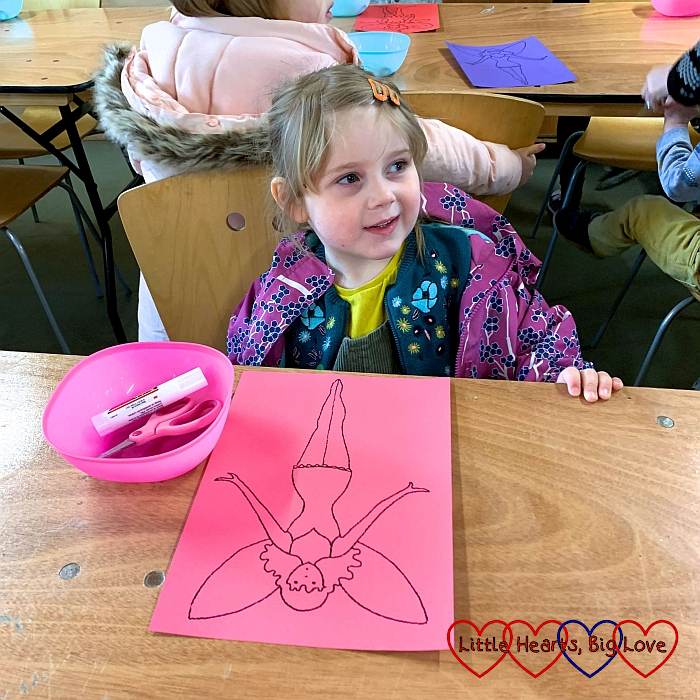 Sophie with her outline fairy picture and a bowl contained a glue stick and a pair of scissors
