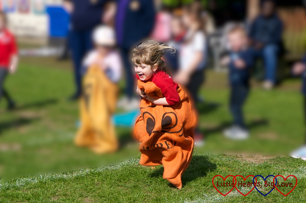 Sophie jumping up and down in the sack race at her Girls' Brigade sports day