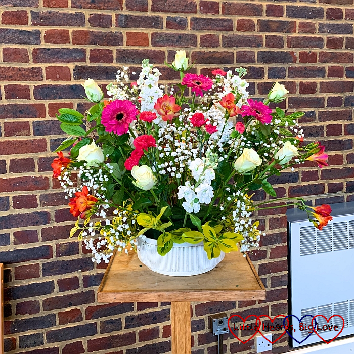 My flower arrangement at church with pink gerberas, orange and pink freesias, cream roses and gypsophilia