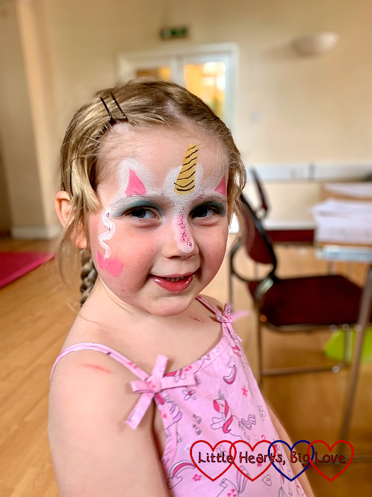 Sophie with her face painted as a unicorn