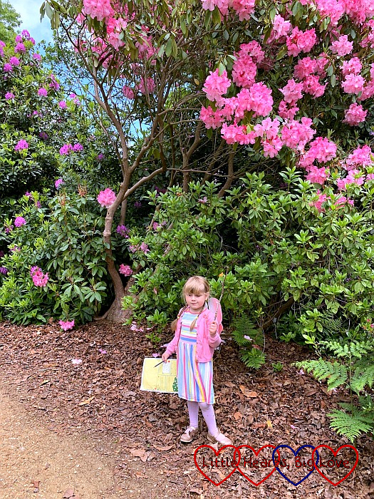 Sophie dressed as a fairy against a backdrop of pink rhododendrons in Langley Park