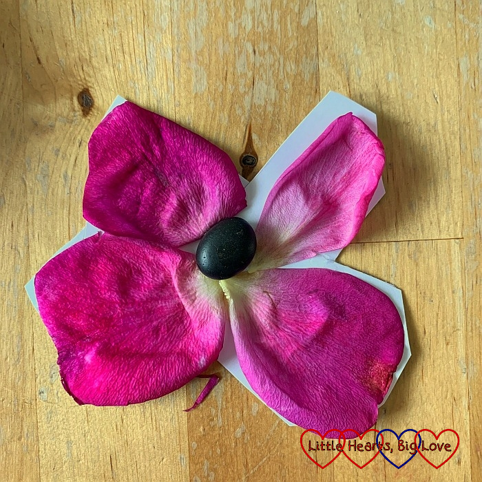 A flower that Sophie made using a pebble and petals