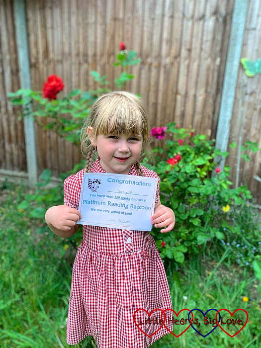 Sophie with her Platinum Reading Raccoon certificate