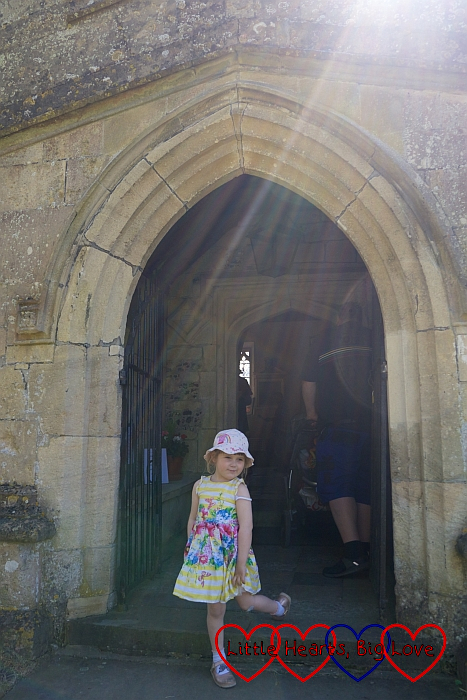 Sophie in the entrance of St Giles Church in Imber