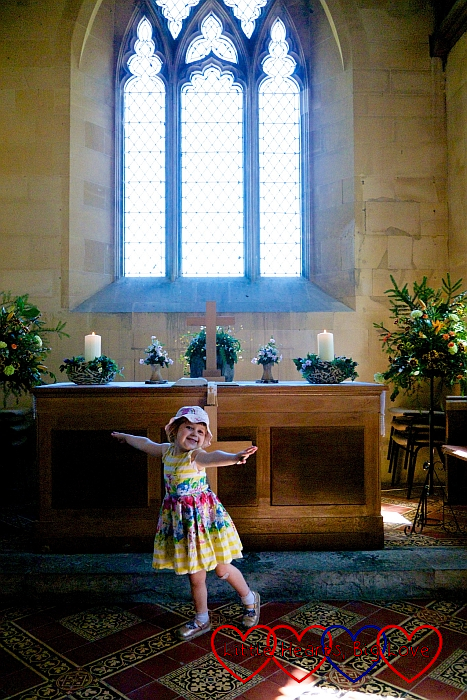 Sophie standing in front of the altar at St Giles Church