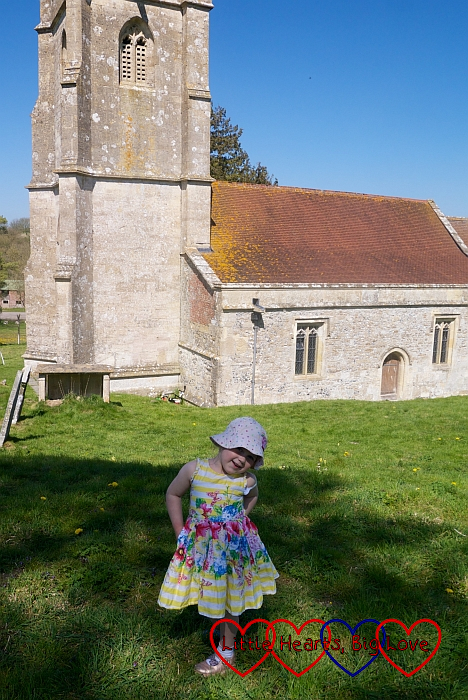 Sophie standing outside St Giles Church in Imber