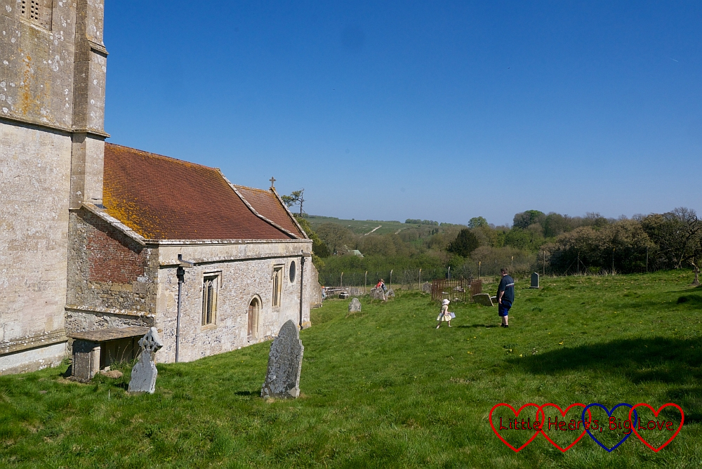 Sophie and hubby exploring the churchyard in Imber