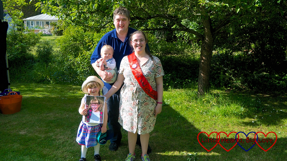 Me wearing a 40th birthday sash, Sophie holding a picture of Jessica and hubby holding Thomas at my 40th birthday barbecue