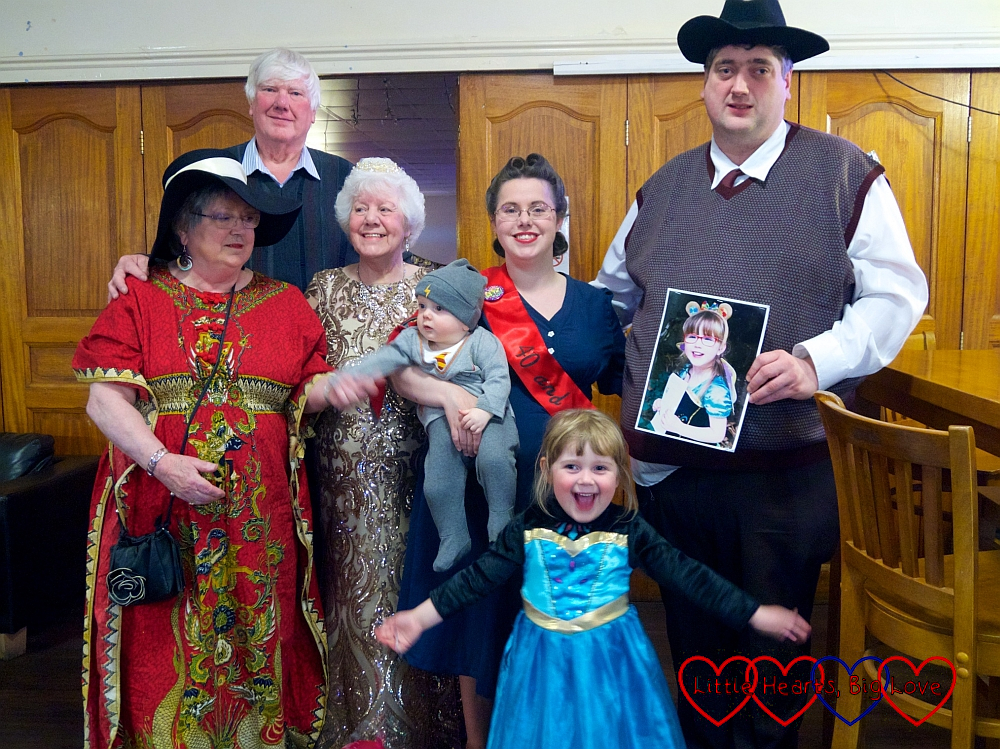 Me and hubby (in 1940s outfits), Thomas (dressed as Harry Potter) and Sophie (dressed as a princess) with a picture of Jessica in a princess outfit, plus my mum (dressed as the Queen) and my in-laws at my 40th birthday party