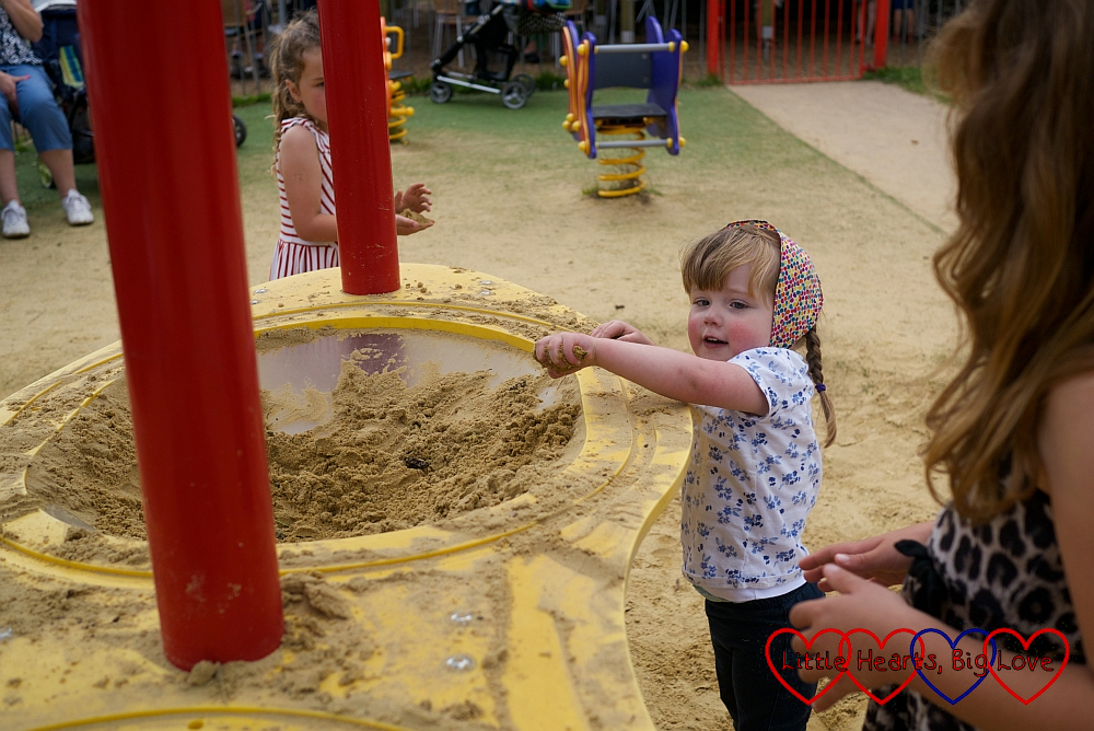 Jessica, aged 3, playing in the sand at Petersfield Heath
