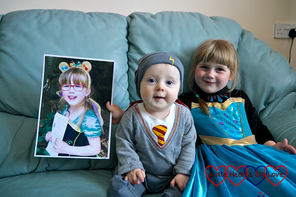 A picture of Jessica wearing a princess dress; Thomas in a Harry Potter sleepsuit; Sophie in a princess dress