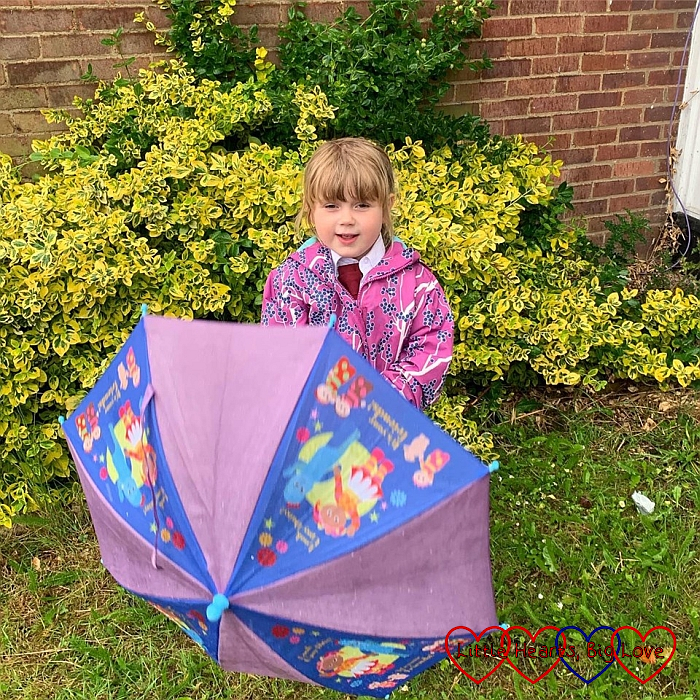 Sophie holding her umbrella