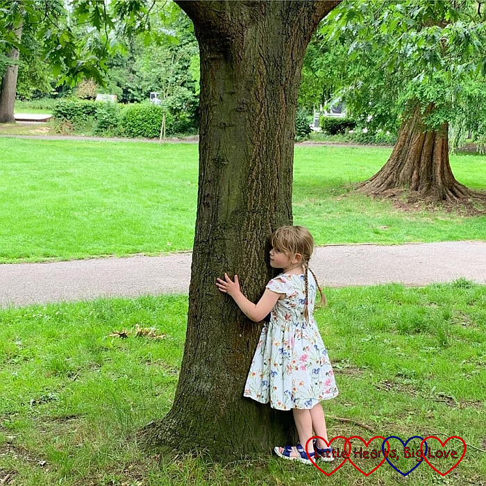 Sophie hugging a tree
