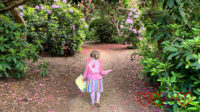 Sophie wearing fairy wings and walking through the Temple Gardens at Langley Park