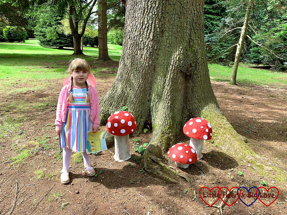 Sophie standing by the toadstools in Toadstool Town