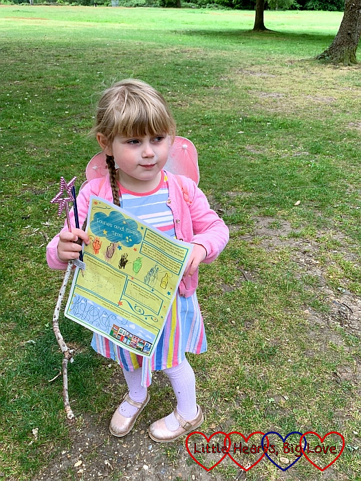 Sophie with her activity sheet and pink sparkly wand
