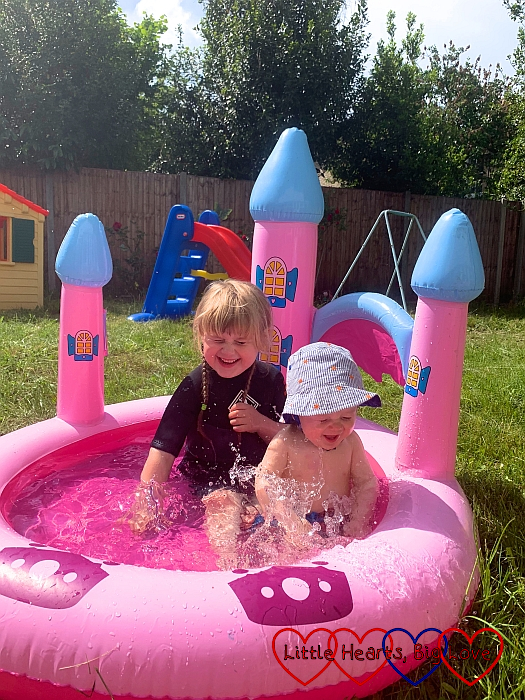 Sophie and Thomas in the paddling pool