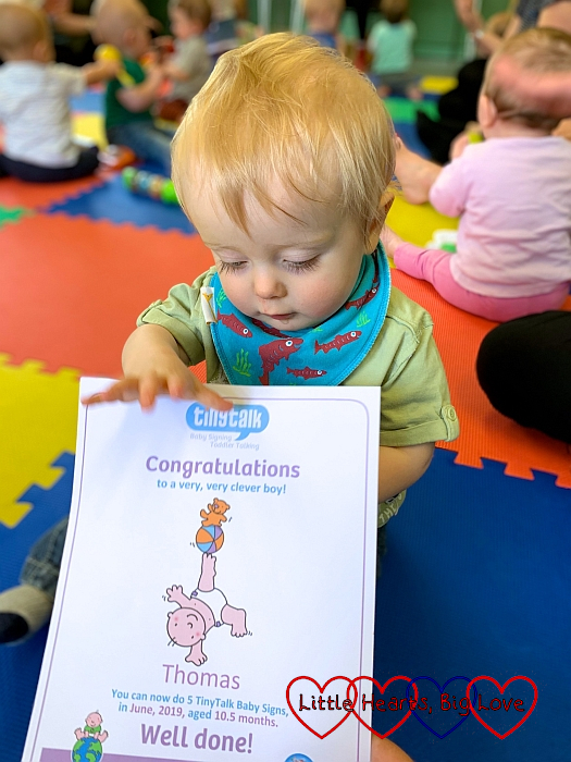Thomas with his five signs certificate from Tiny Talk