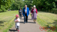 Sophie walking in front of the mayor and mayoress