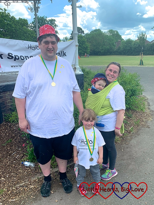 Hubby, Sophie and me (with Thomas in the wrap) with our medals at the end of the sponsored walk