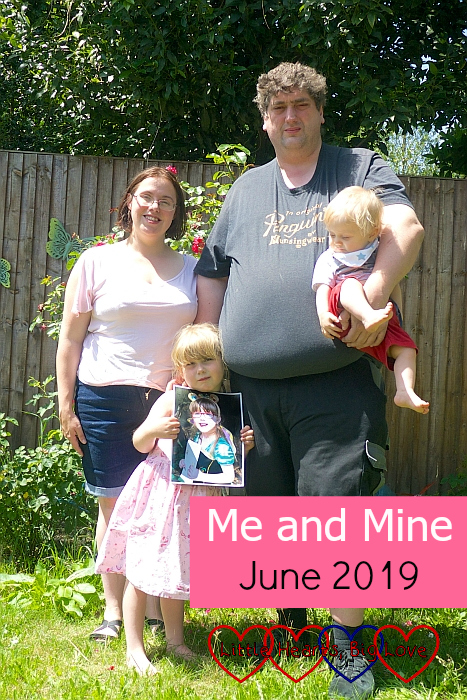 "Me, hubby holding Thomas, and Sophie holding a photo of Jessica in the garden in the sunshine - ""Me and Mine: June 2019"""